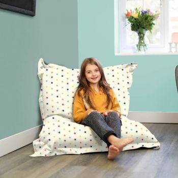 Rainbow Stars Beanbag in cream used as a lounger