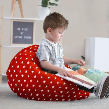 Little boy reading on red stars bean bag