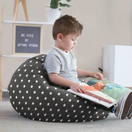 Little boy reading on charcoal grey stars bean bag