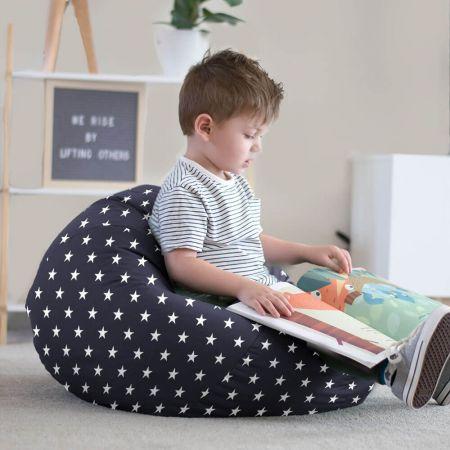 Little boy reading in stars bean bag