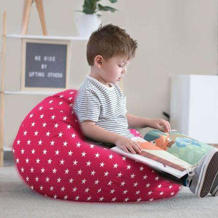 Little boy reading on stars bean bag