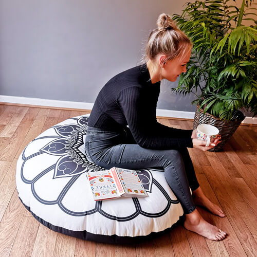 Black and Cream Mandala Floor Cushion indoors