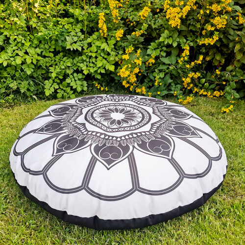 Black and Cream Mandala Floor Cushion outdoors