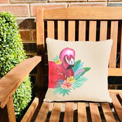 Outdoor flamingo cushion on garden bench