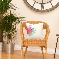 Flamingo cushion on rattan chair