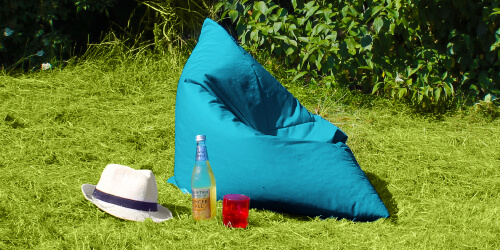 Large outdoor floor cushion outdoors used as a seat