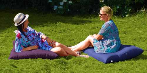 Large outdoor floor cushion in the garden