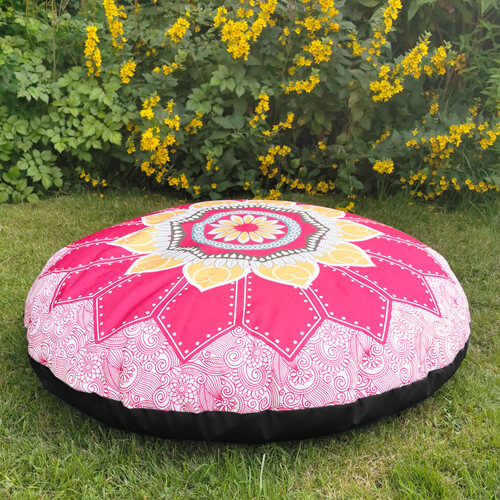 Red and Gold Mandala Floor Cushion outdoors