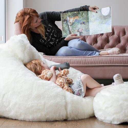 Cream fur bean bag with mum and daughter