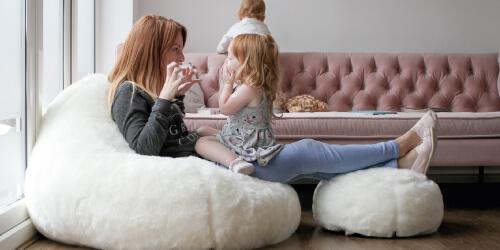 Cream fur bean bag with mum and daughter