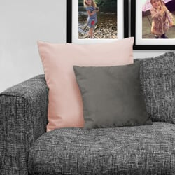 grey faux suede cushion on sofa