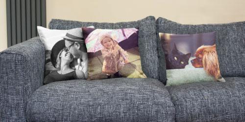 Three Photo Cushions on Sofa