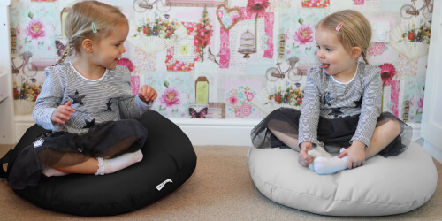 two little girls on smarty floor cushions