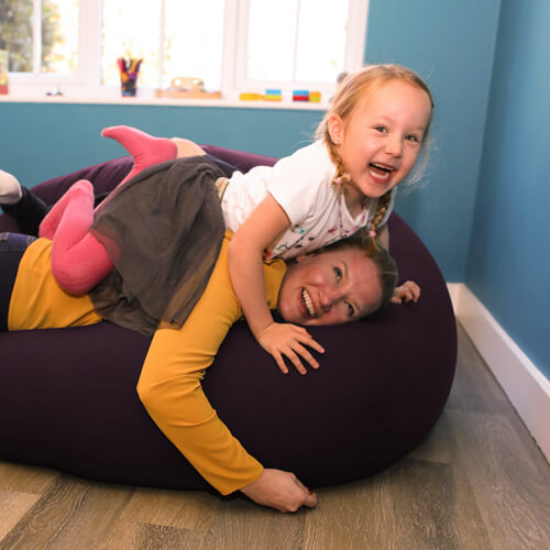 Adult and child on goliath beanbag