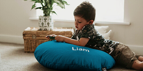 Little boy on personlaised smarty floor cushion