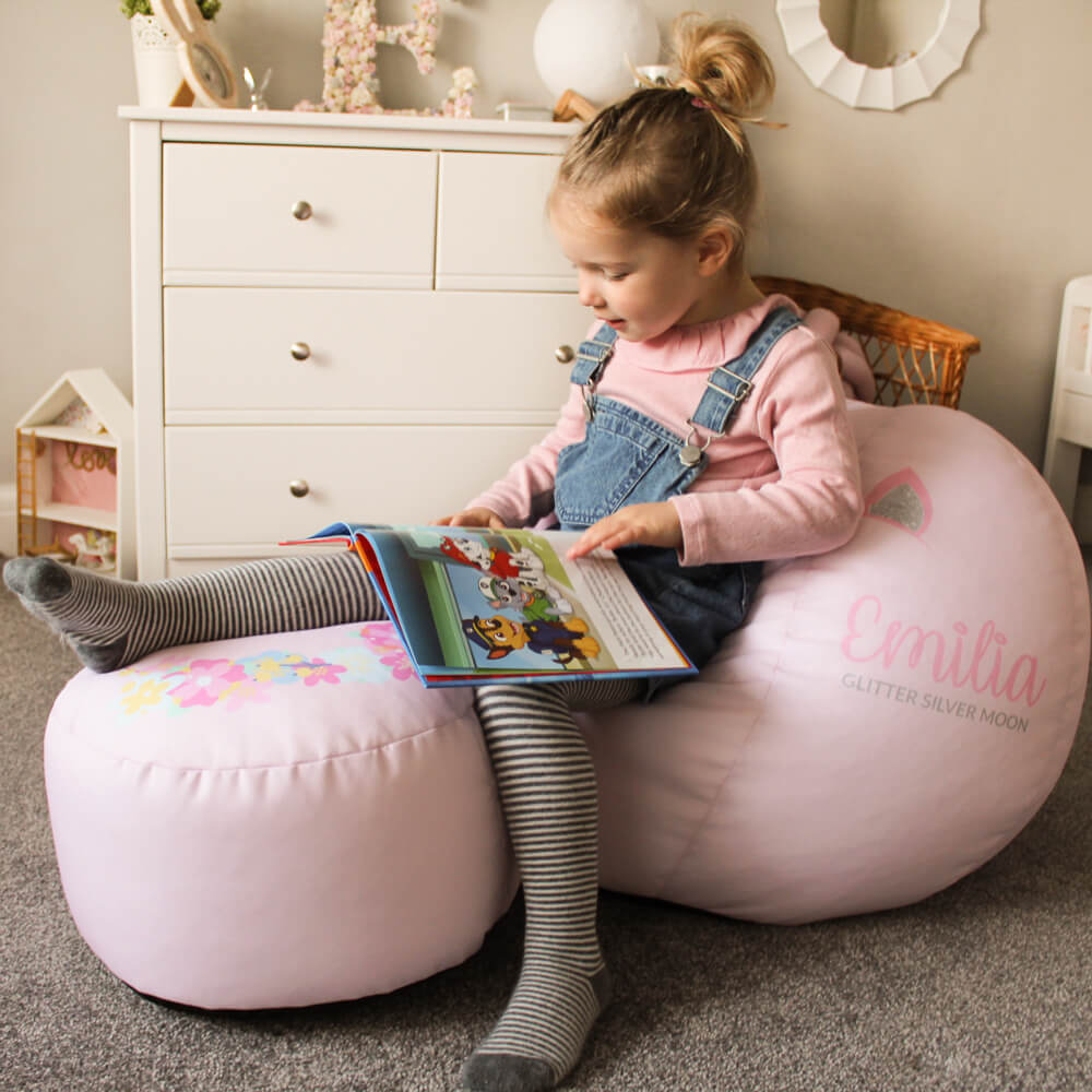 Little girl with 3D unicorn beanbag and unicorn kids stool