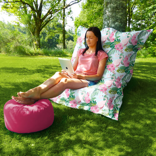 Flamingo beanbag in the garden with footstool